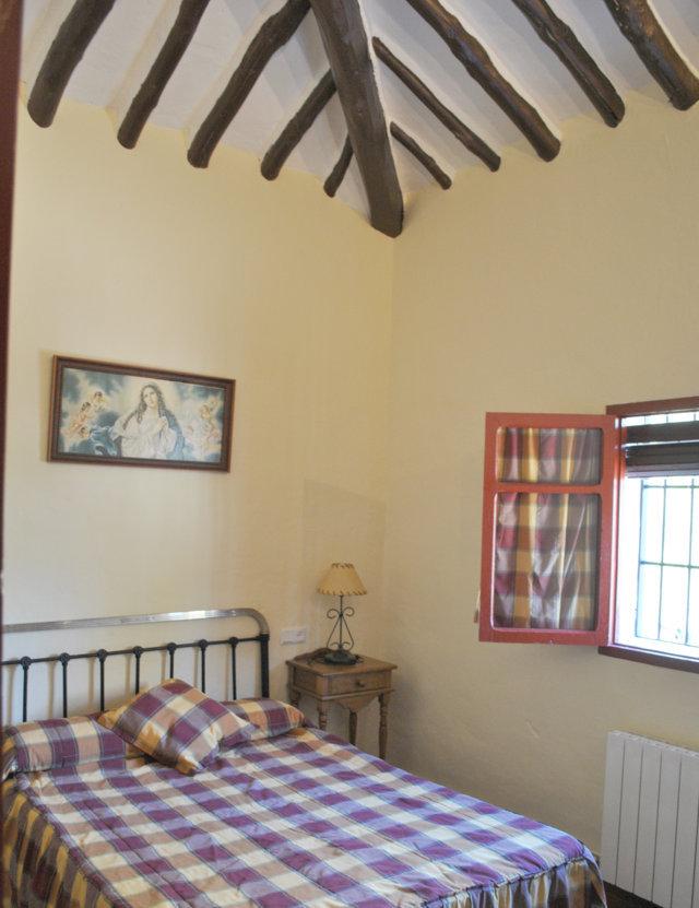 casa pequeña dormitorio 1